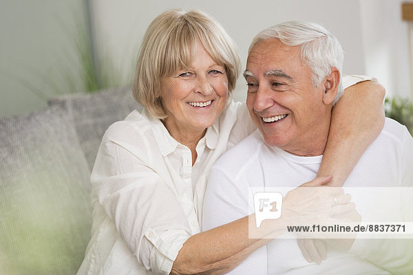 Happy senior couple together in living room