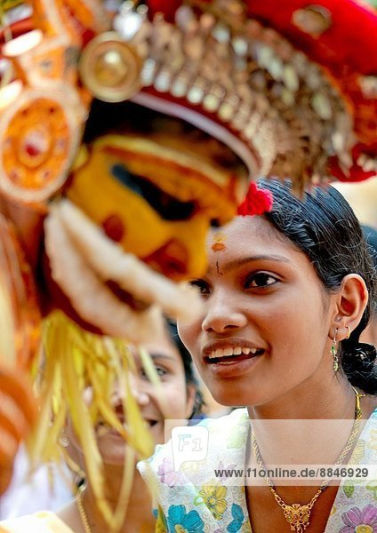 In India  you can attend to a popular Hindu ritual of worship called Theyyam  this ancestral cult has got the particularity of involving all the castes and classes that comprise Hindu society  nevertheless Theyyam can only be performed by male members of particular castes; the term Theyyam is a corrupt form of Devam or God; people of these districts consider the performers of the Theyyam as deities and look forward blessings from this Theyyam; in order to get the appearance of super-human  original and colourful costumes and make-up are used in Theyyam dances; Theyyam tells the story of people who lost their lives on the battlefield  pangs of women who committed suicide or persons killed by the local chieftains  Theyyams performance in front of shrines honour such people; after the dance  people consult also the dancers because they communicate forecasts and see the future  there is a charge for the consultation; taking pictures is not easy as you must not forget that they are gods.