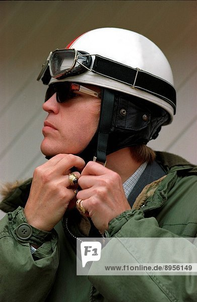 Portrait of a mod / scooter boy holding a helmet on his hand  UK 2000´s.