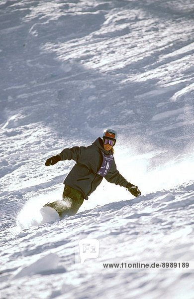 Woman In Extreme Snowboarding Competition  Annual Event In Crested Butte  Colorado