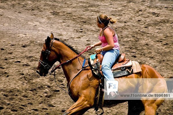 Female barrel racing at local rodeo in Florida. Dade City  Florida