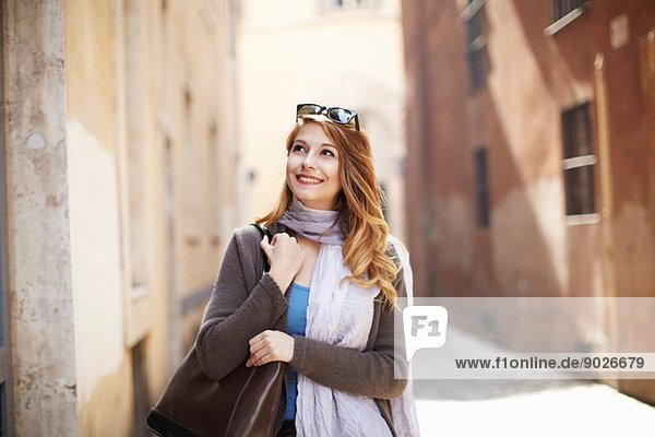 Young sophisticated woman exploring streets  Rome  Italy