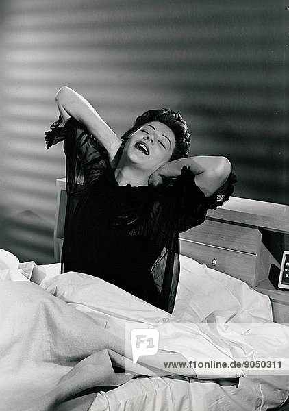 Woman waking up from her bed