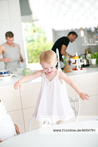 Girl playing in kitchen  Stockholm  Sweden