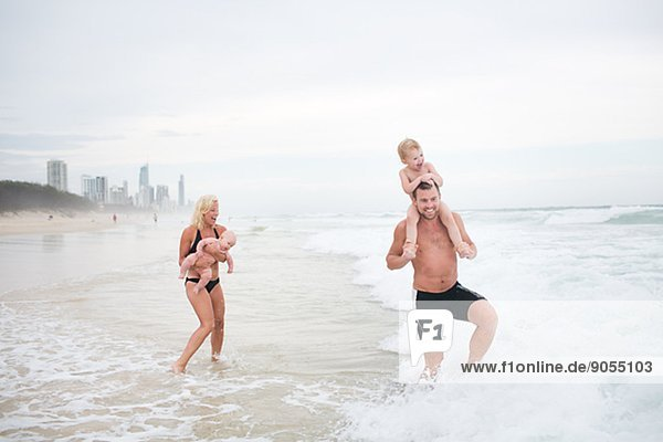 Family with children on beach  Australia