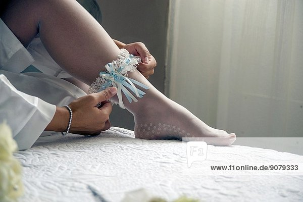 Bride dressing  suspender stockings