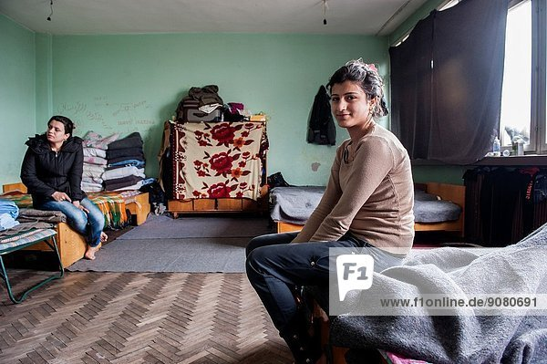 Sofia  Bulgaria. Female Syrian refugee and her nice  living in boredom and without privacy in refugee camp Vrajdebna.