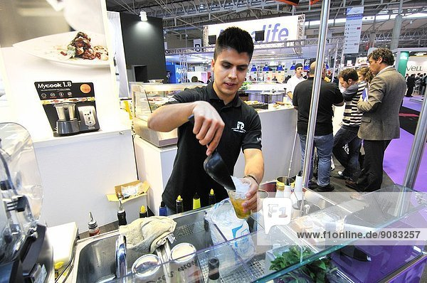 Barman preparing a cocktail in Alimentaria  International Food and Drinks Exhibition  Fira de Barcelona. L´Hospitalet de Llobregat  Barcelona  Catalonia  Spain.