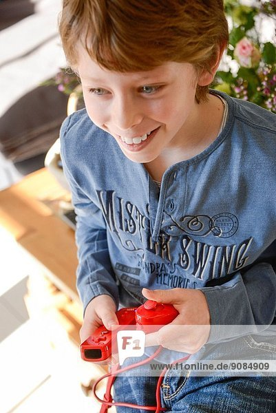 9 years old boy play video game.