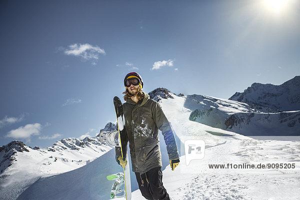 Austria  Vorarlberg  Riezlern  Snowboarder in the mountains