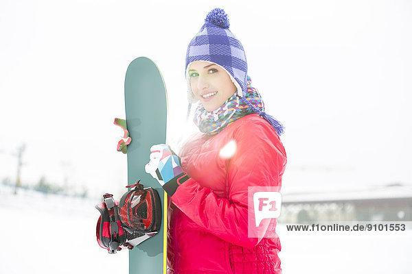 Portrait  Frau  Snowboard  Schönheit  halten  jung  Schnee