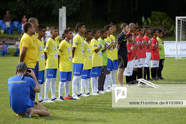 Teams from Brazil and Egypt singing their national anthems before a game  Street Children World Cup 2014  Rio de Janeiro  Rio de Janeiro State  Brazil