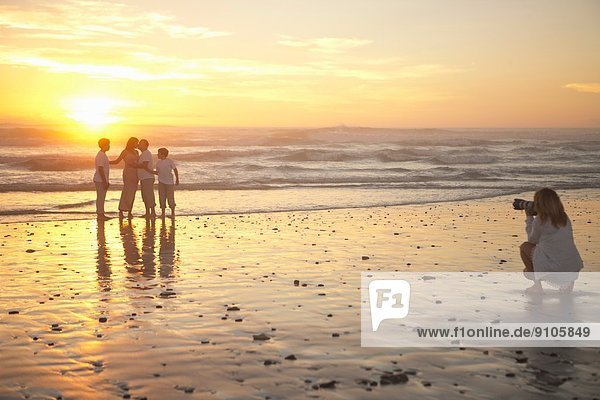 Photographer taking family portrait on beach  Cape Town  South Africa