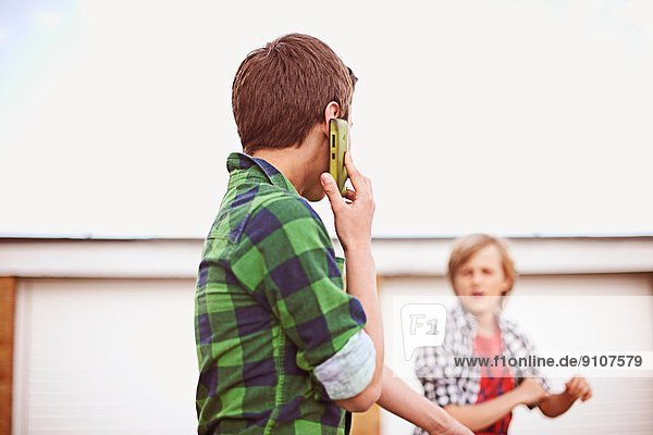 Boy on cell phone