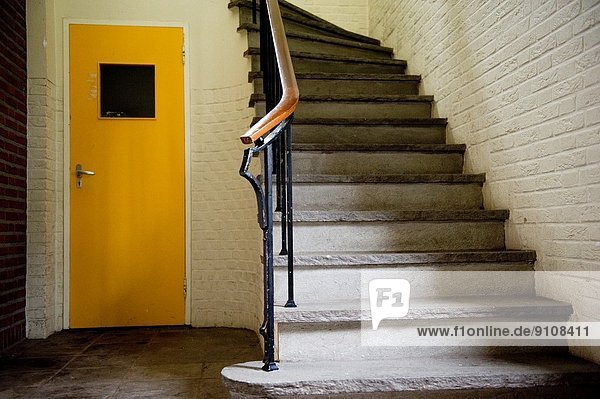 Stairs in a former Dutch monastery and hospital  built in 1943  which has been abandoned.