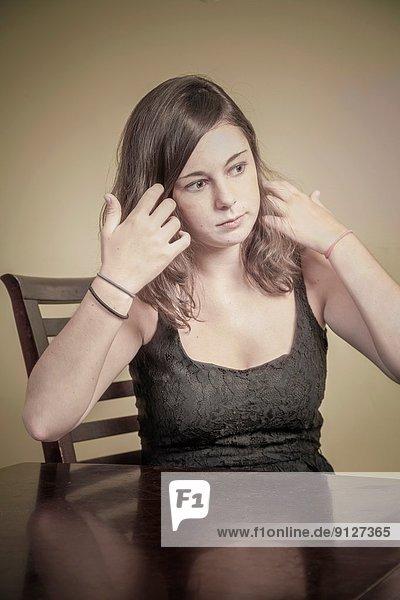 Teen girl in her dining room.