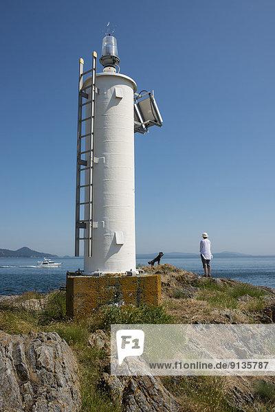 Frau  Hund  Leuchtturm  Gulf Islands  Bake  British Columbia  Kanada
