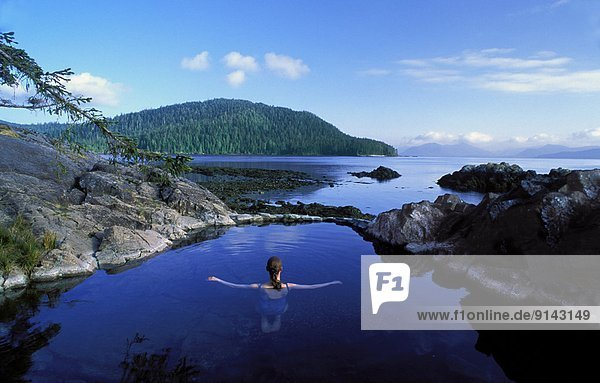 Woman in natural hotspring pool  Gwaii Haanas National Park  Queen Charlotte Islands  British Columbia  Canada