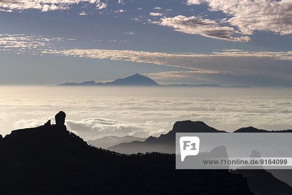 View from Pico de las Nieves in Gran Canaria across Roque Nublo to Mount Teide in Tenerife  La Culata  Risco Blanco  Canary Islands  Spain