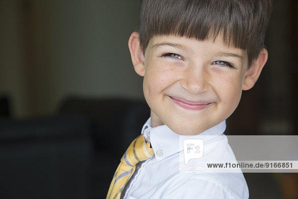 Caucasian boy smiling in formal wear