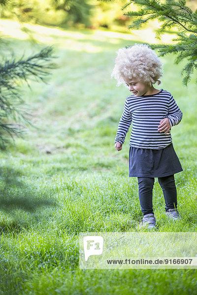 Mixed race girl walking outdoors Mixed race girl walking outdoors
