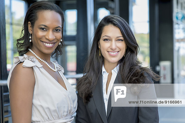 Businesswomen smiling outdoors