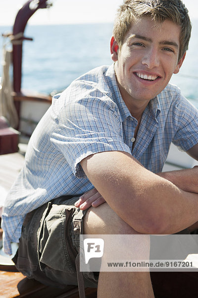 Caucasian man relaxing on sailboat