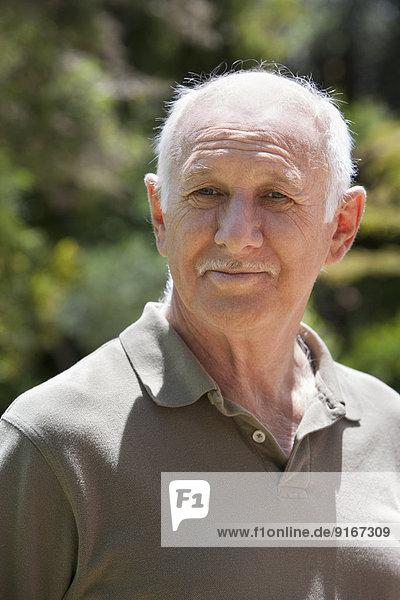 Senior Caucasian man smiling outdoors