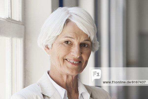 Senior Caucasian businesswoman smiling in office