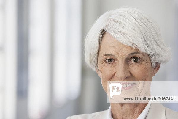 Senior Caucasian businesswoman smiling