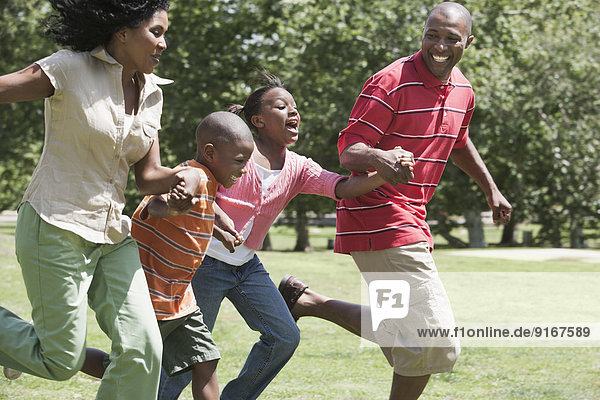 Family running together in park