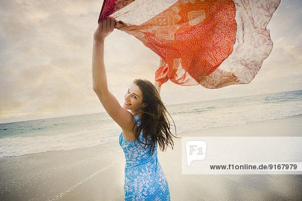 Caucasian woman playing on beach