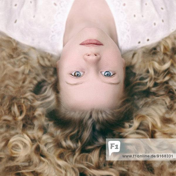 Caucasian girl laying on ground