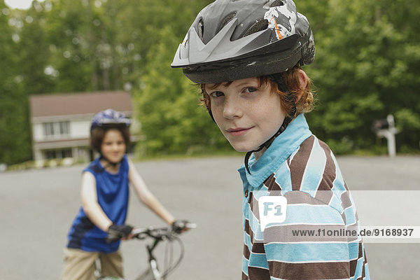 Boys riding bicycles together outdoors
