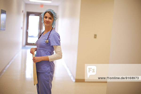 Caucasian nurse wearing hair net in hospital