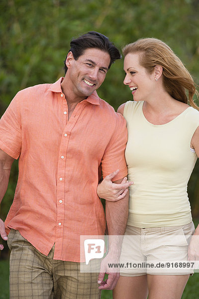 Caucasian couple walking together outdoors