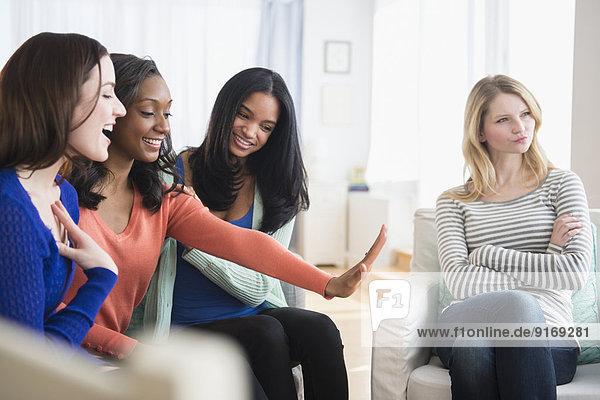 Jealous woman ignoring friend's engagement ring