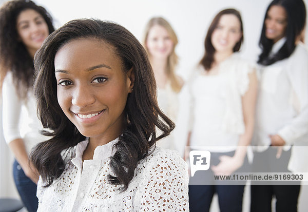 Woman smiling with friends