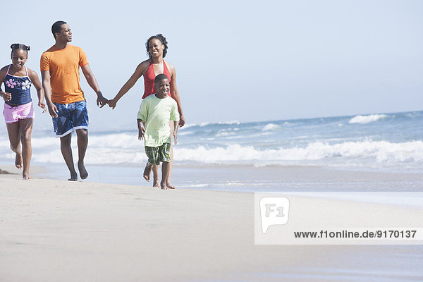 Family walking together on beach