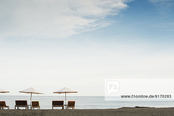 Silhouette of tables and chairs on beach Silhouette of tables and chairs on beach