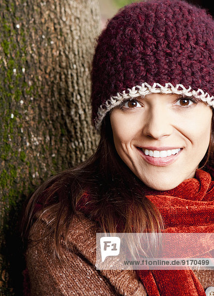 Mixed race woman wearing hat and scarf outdoors