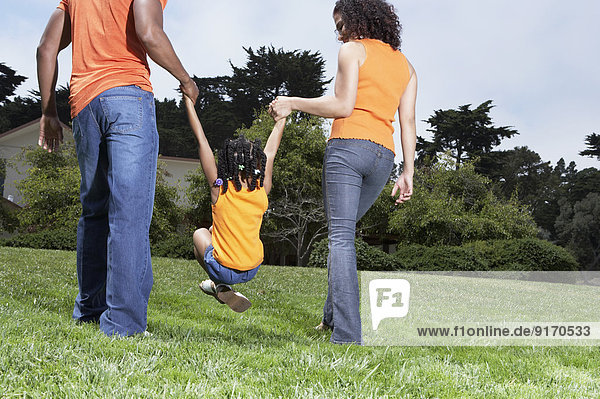 Family playing together in park
