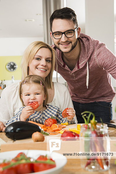 Portrait of family cooking in kitchen at home