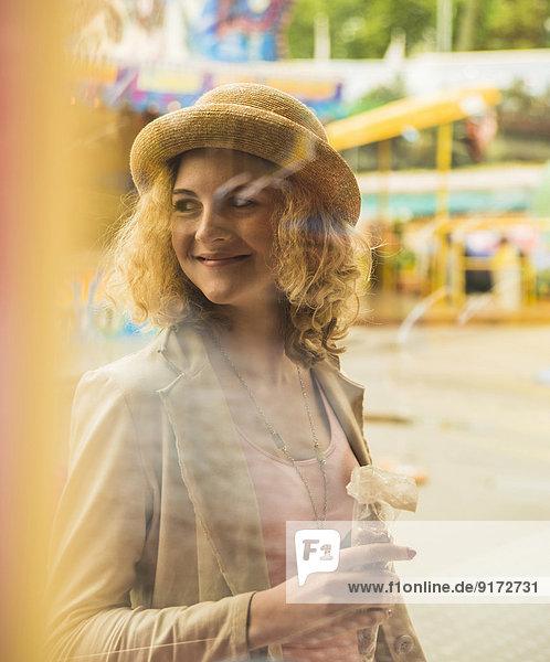 Portrait of smiling teenage girl at fun fair