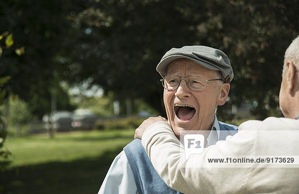 Portrait of happy old man having fun with his friend