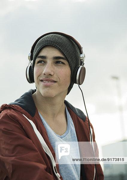 Boy wearing headphones outdoors
