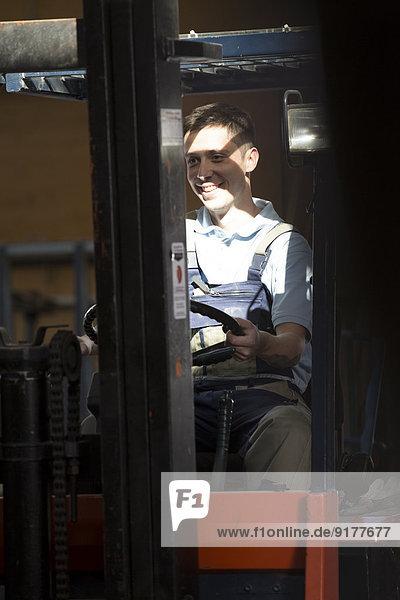 Warehouseman on forklift truck