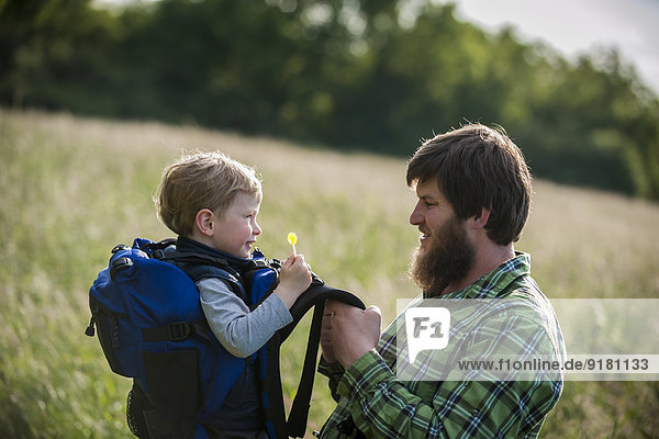 Germany  Rhineland-Palatinate  Moselsteig  father and his little son having a break from hiking