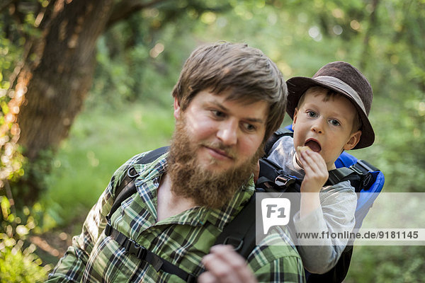Germany  Rhineland-Palatinate  Moselsteig  portrait of father and his little son hiking