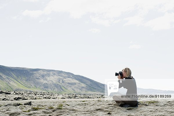 Frau Landschaft fotografieren